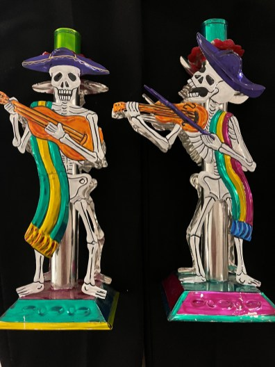 """This couple of tin work musicians stand 10"""" tall and hold candles for the Day of the Dead ofrenda."""