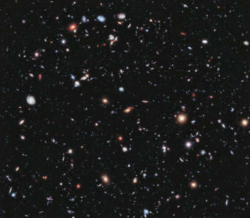 This is the Hubble eXtreme Deep Field, a composite of 2 millions seconds from images taken over the previous ten years! Each bright spot is an entire galaxy, the dimmest of which is less than one ten-billionth as bright as the minimum brightness that we can see with our eyes.