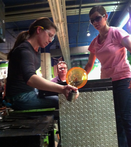 sam shaping a glass bowl - learning glass blowing