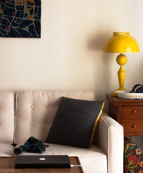 gray and orange x-stitch textured throw pillow