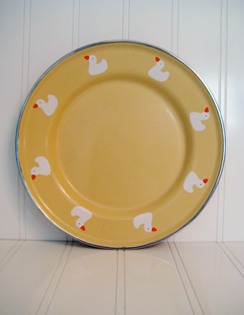 tin plate with ducks on it