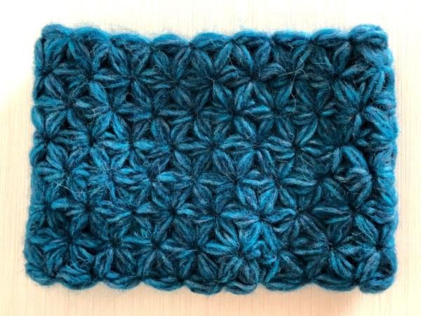 A blue crochet Jasmine Cowl made with jasmine stitches