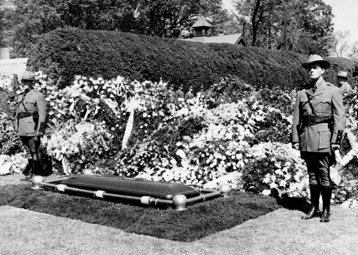 New York State Police guard the grave of President Franklin D. Roosevelt on his estate at Hyde Park, N.Y., April 15, 1945, following his funeral. (AP Photo)