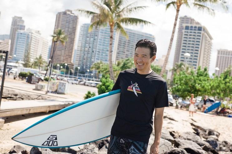 Guy Hagi with board, FLUX Hawaii