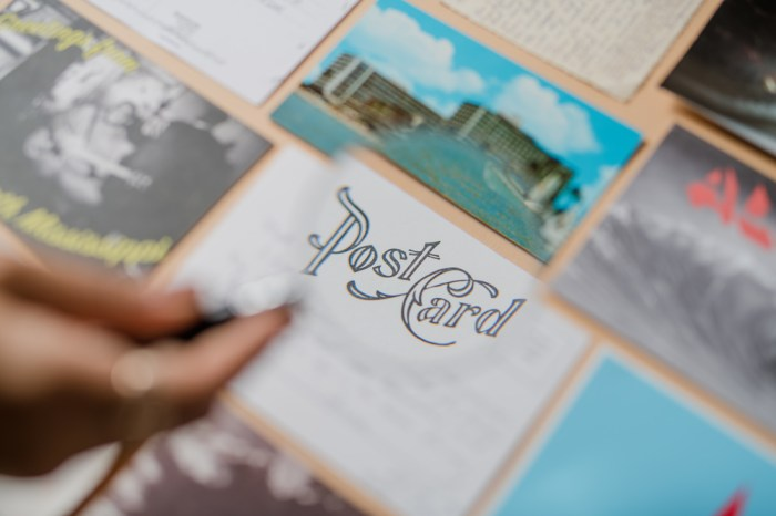 postcard with magnifying glass