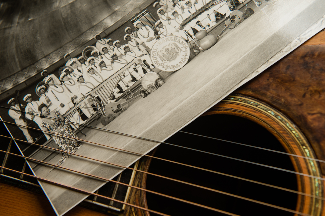 detail on guitar strings with historic hawaii photo