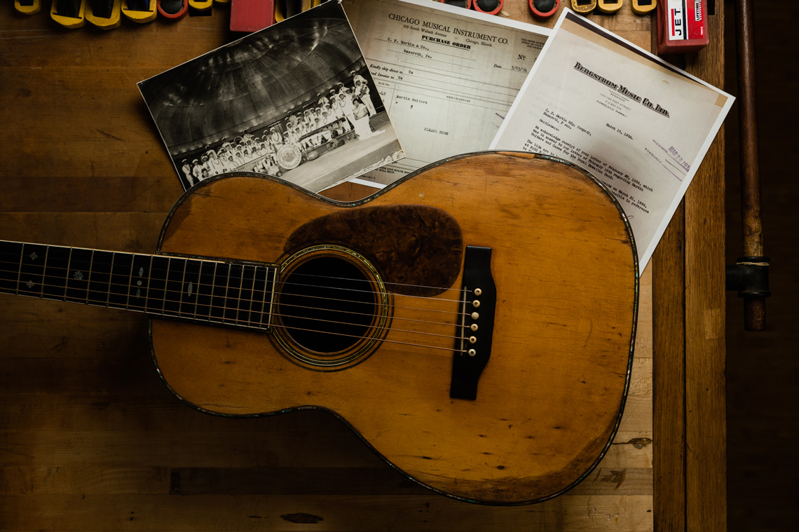 vintage guitar with historic documents