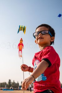 kid flying kite