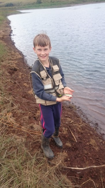 Sam with his 1st Fish caught on his own! They did get bigger.