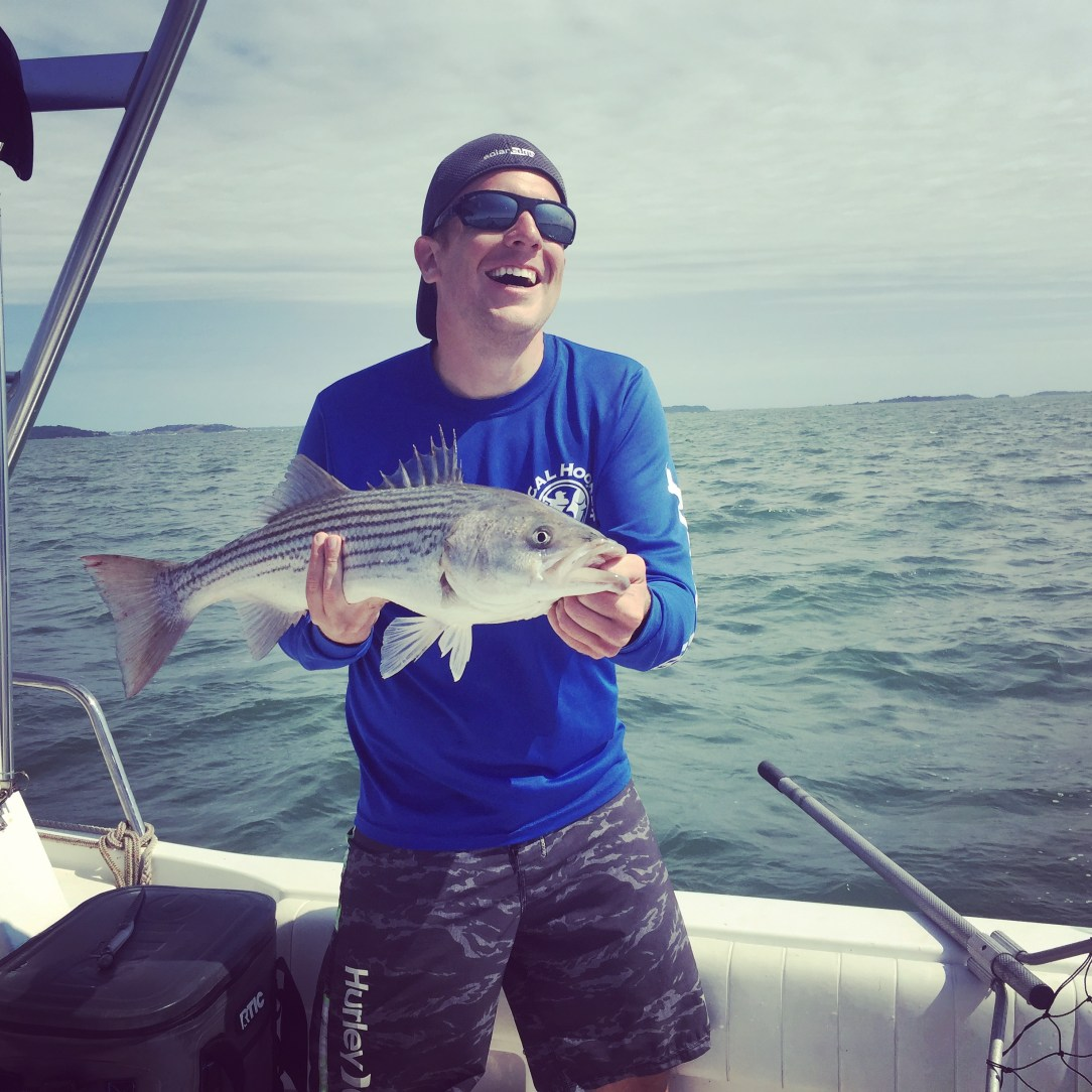 "Eric holding up a 32"" Striped Bass"
