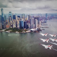 THE THUNDERBIRDS AND RED ARROWS FLY OVER THE HUDSON RIVER IN NEW YORK CITY