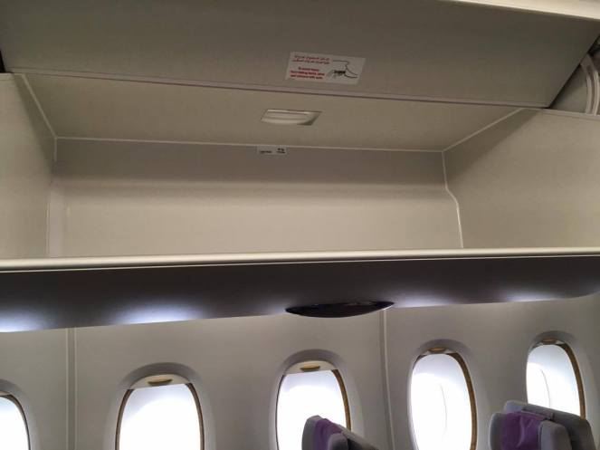 An empty overhead bin in economy on Emirates Airbus A380