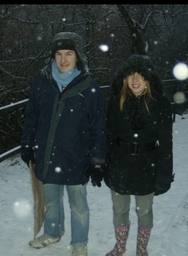 Rosie and Karl in Budapest, Hungary wearing large winter coats in the snow