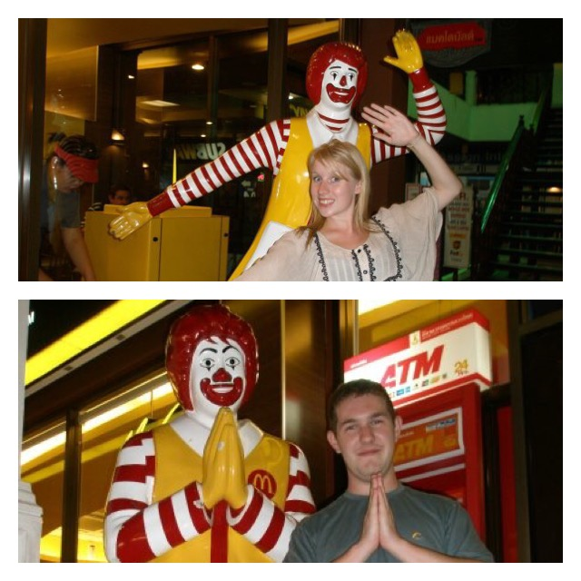 Rosie and Karl stand in front of Ronald McDonald's statues outside McDonald's in Thailand