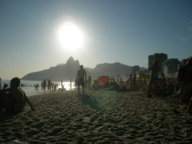 Ipanema beach with the sun setting behind Two Brothers hills