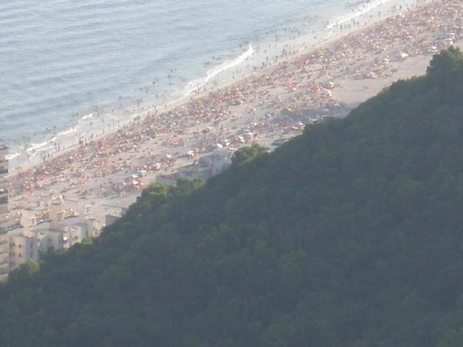 Photo of a busy beach from the hills above Rio de Janeiro