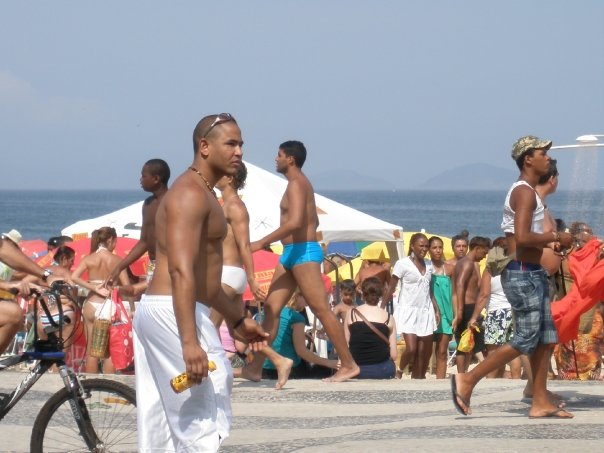 People walk along the promenade at Ipnema beach