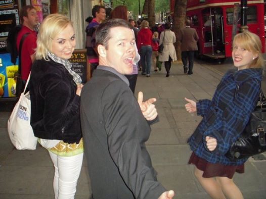 Rosie out with her Harrods colleagues pose for a photo on a London street