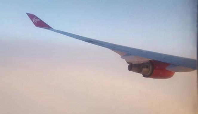 Virgin Atlantic Boeing 747 plane wing and red Rolls Royce engine