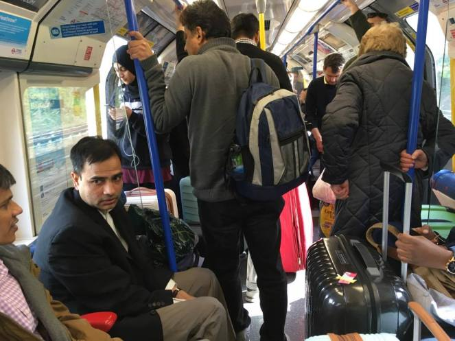 A busy Piccadilly Line train interior