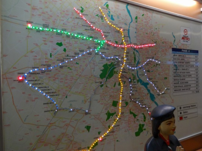 a map of the Delhi metro lit with coloured lights