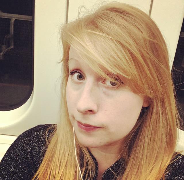 Rosie Fluskey on an underground train