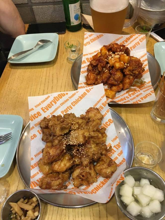 2 plates of Korean fried chicken and side dishes at Chicken 678, Seoul, South Korea