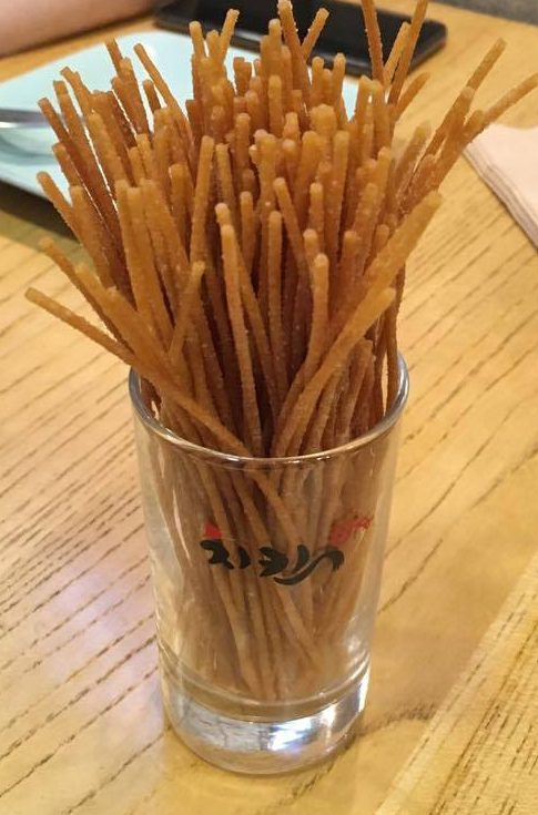 deep fried spaghetti sticks in a glass at Chicken 678 in Seoul, South Korea