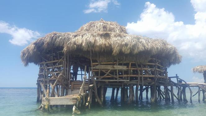 Floyd's Pelican Bar - a wooden floating bar with palm roof in the Caribbean Sea, Jamaica