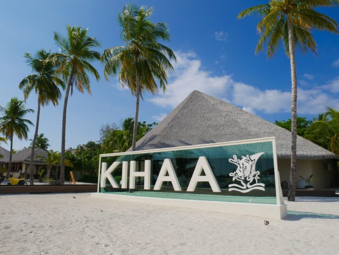 Kihaa Maldives sign on the beach with palm trees