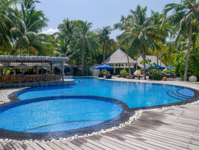 round swimming pools surrounded by wooden decking at Kihaa Maldives