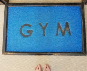 blue welcome mat with GYM written on it at Kihaa Maldives