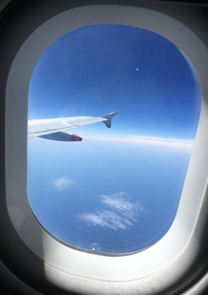 View out of the window of the wing of a British Airways Airbus A320