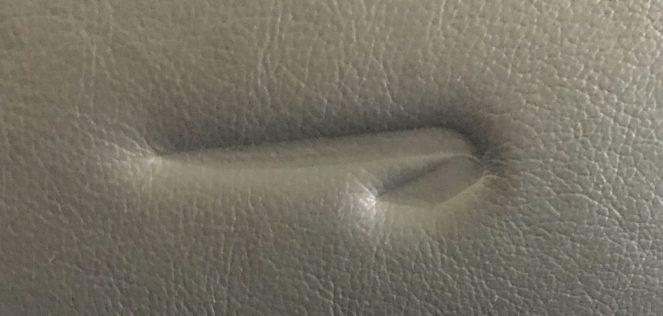 British Airways logo in a leather aeroplane seat