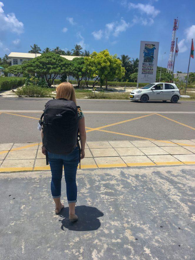 Rosie wearing a black Kathmandu Litehaul 38L backpack in the Maldives