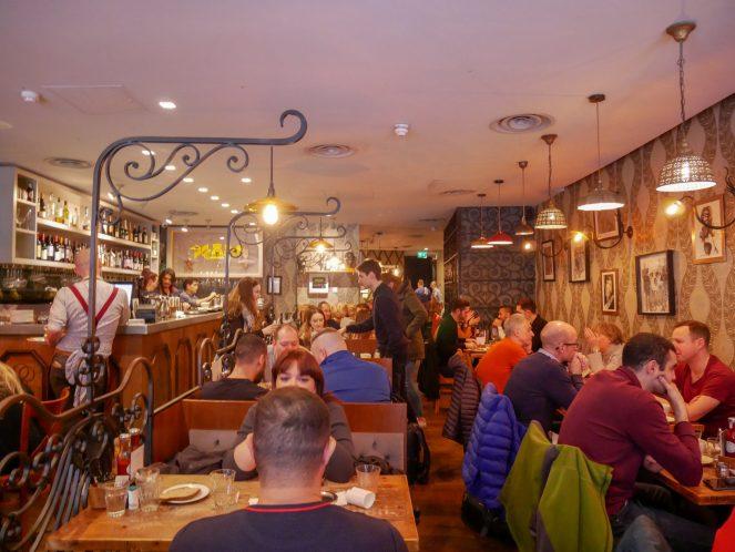 busy tables inside Balans Soho, London