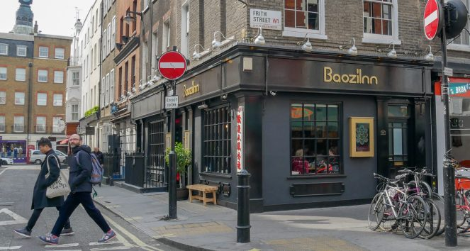 the black walls and sign of Boazilnn restaurant on the corner of Frith Street and Romilly Street, Soho, London