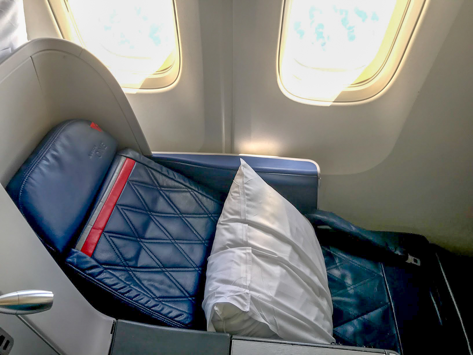 Delta One seat reclining on a Delta Air Lines Boeing 767