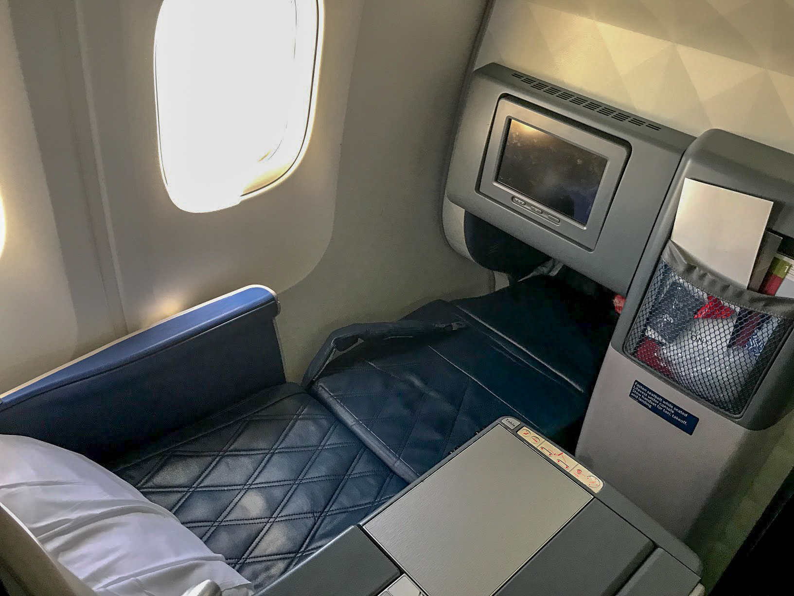 Delta One seat reclined on a Delta Air Lines Boeing 767