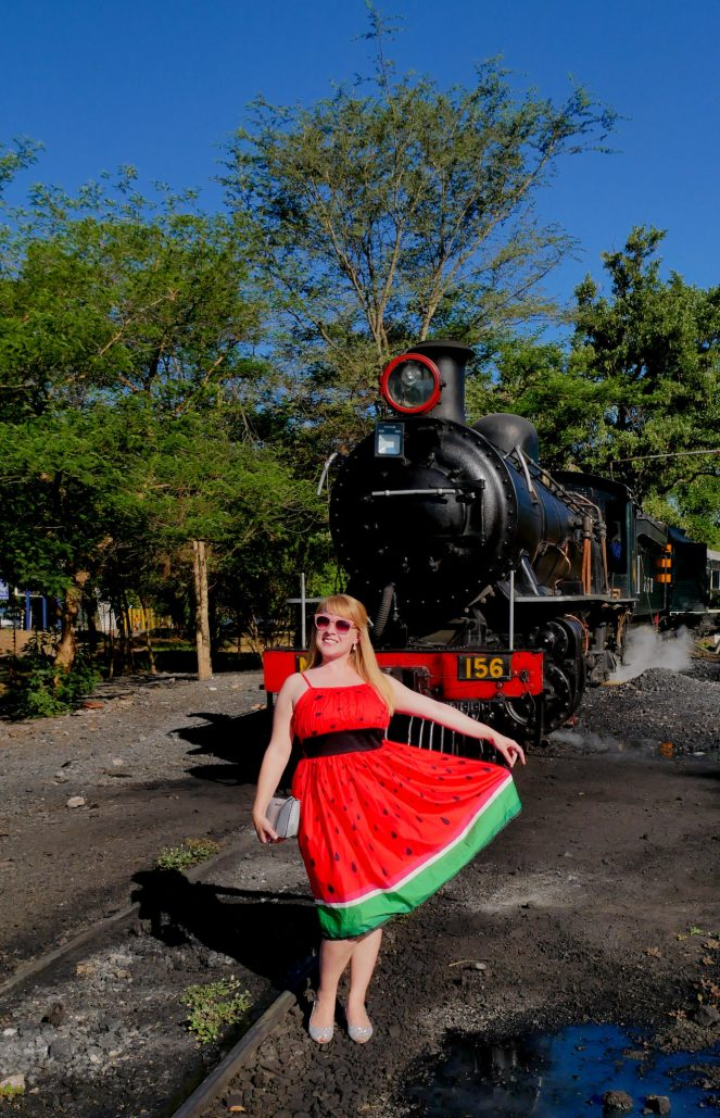 Rosie stands in front of the Royal Livingstone Express steam engine
