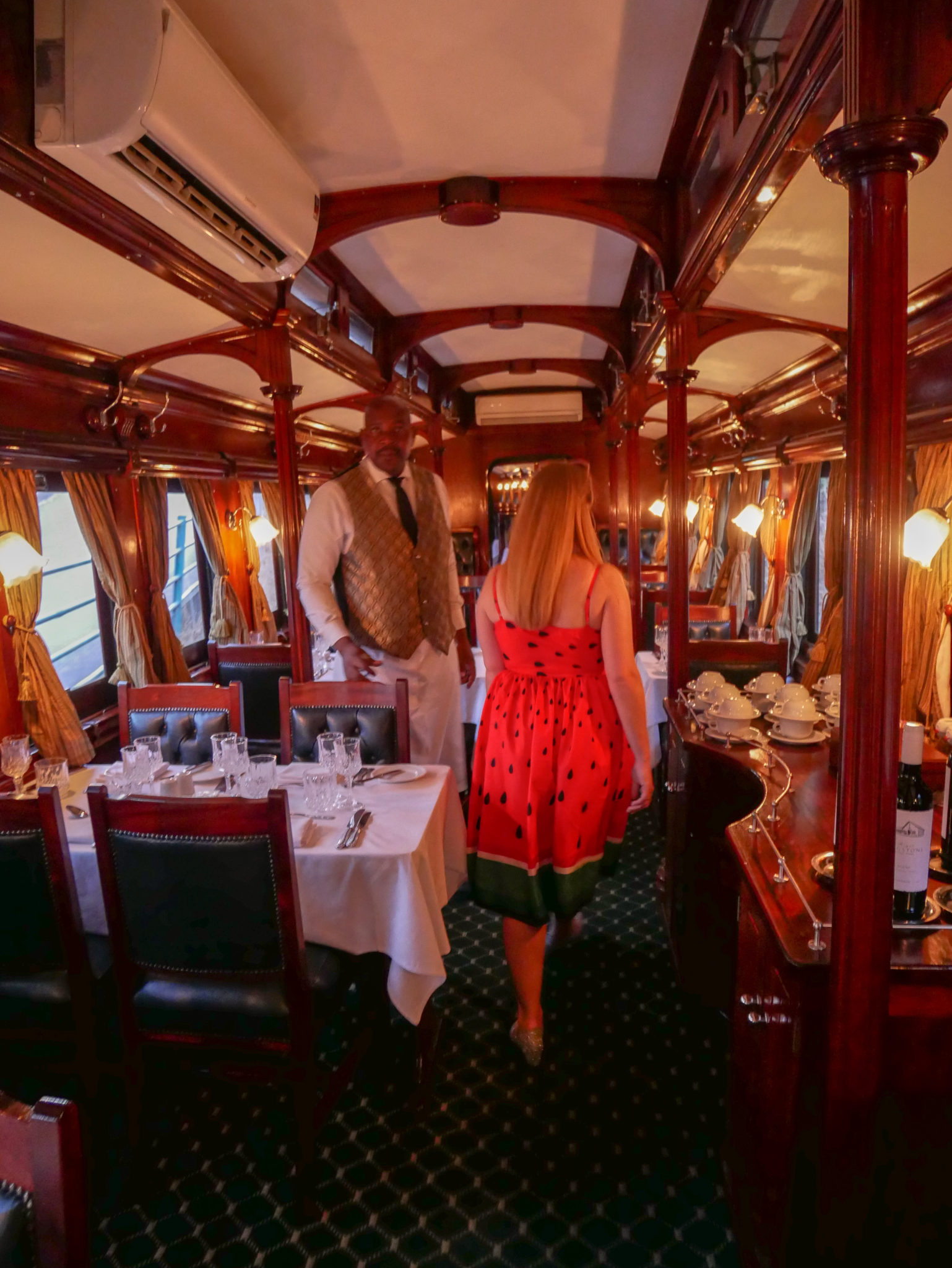 Rosie walks through the Dining Car of the Royal Livingstone Express train