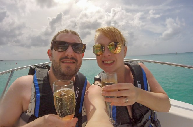 A GoPro selfie with two soggy fluskeys clutching champagne on the boat.