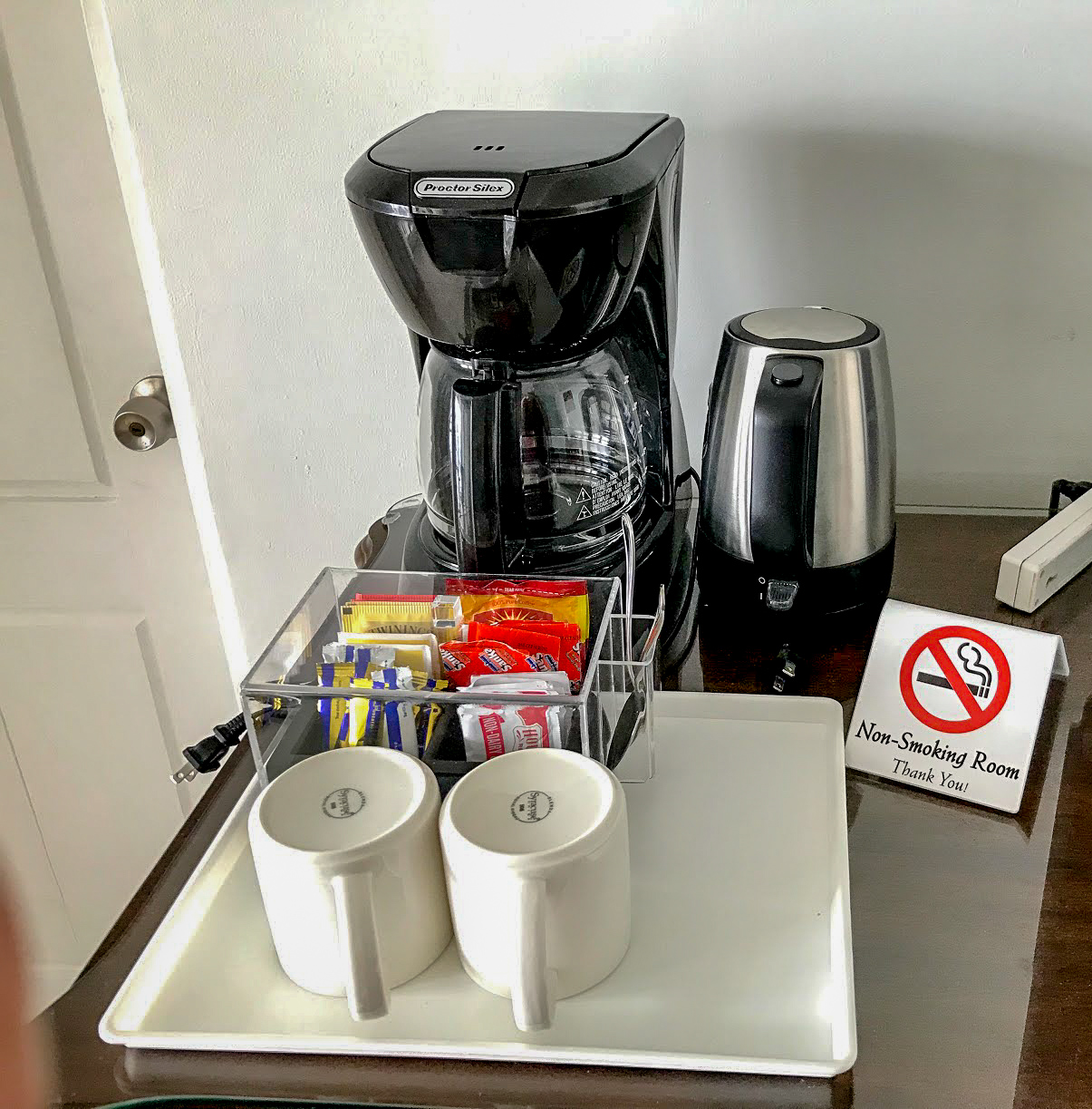 A coffee machine, tea bags, mugs and all the other things you need to make caffeine-filled joy