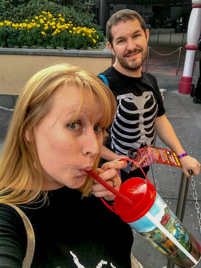 A selfie of Karl & Rosie, who sucks a drink through a red plastic straw