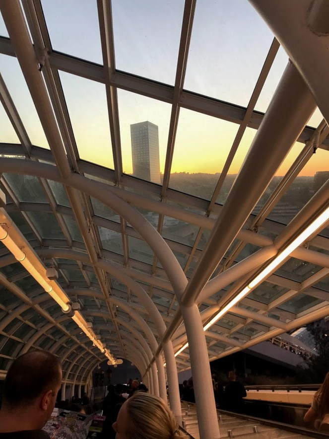 The sun begins to set through the glass of the SkyWalk escalator roof