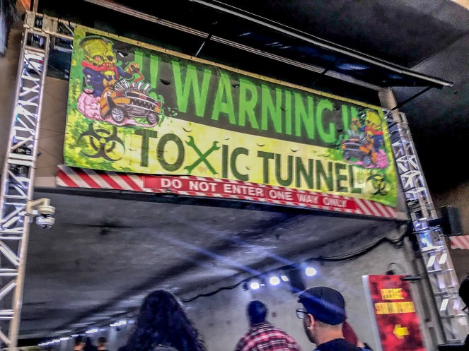 A blurry picture of the toxic tunnel sign