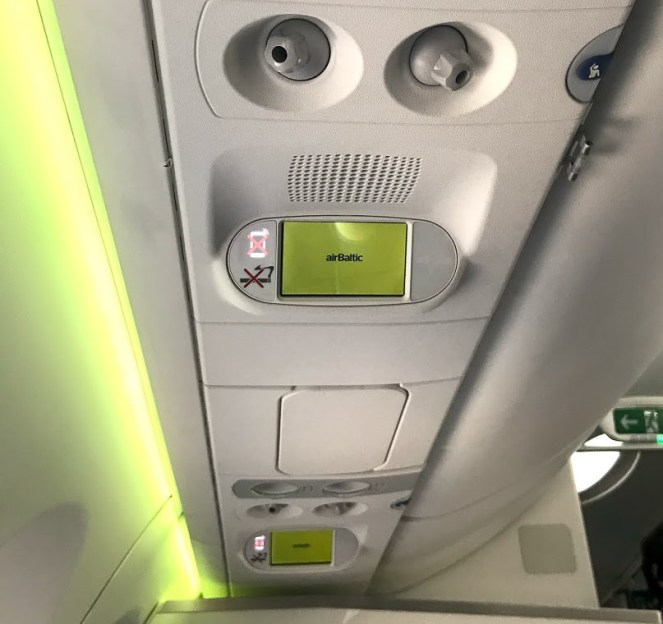 airBaltic A220-300 air vents, speaker and screen
