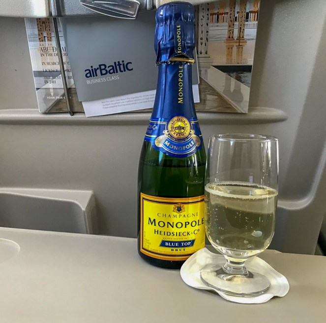 airBaltic A220-300 business class Monopole Brut Champagne bottle and glass