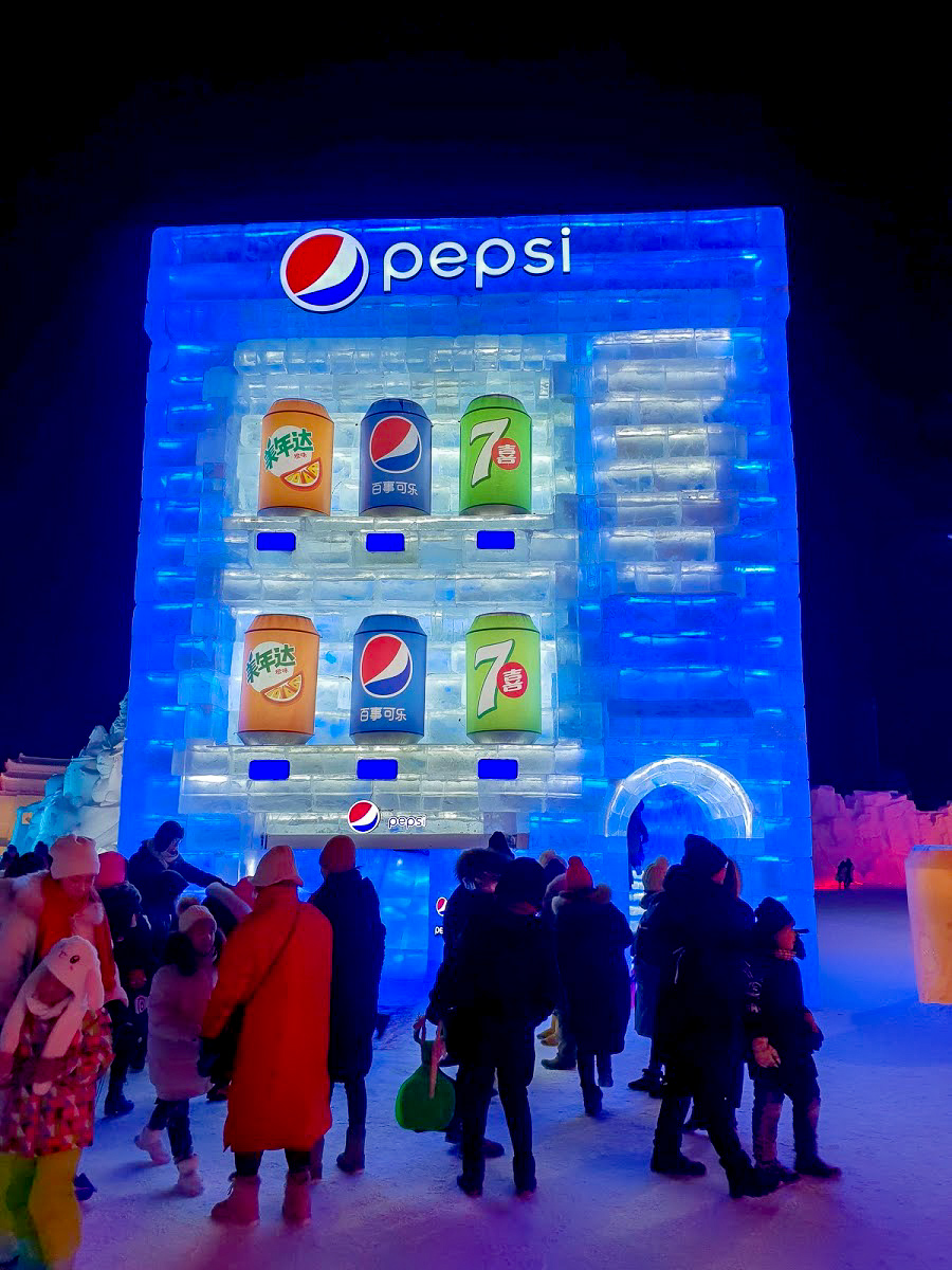 A giant blue Pepsi vending machine made of ice at Harbin Ice and Snow World