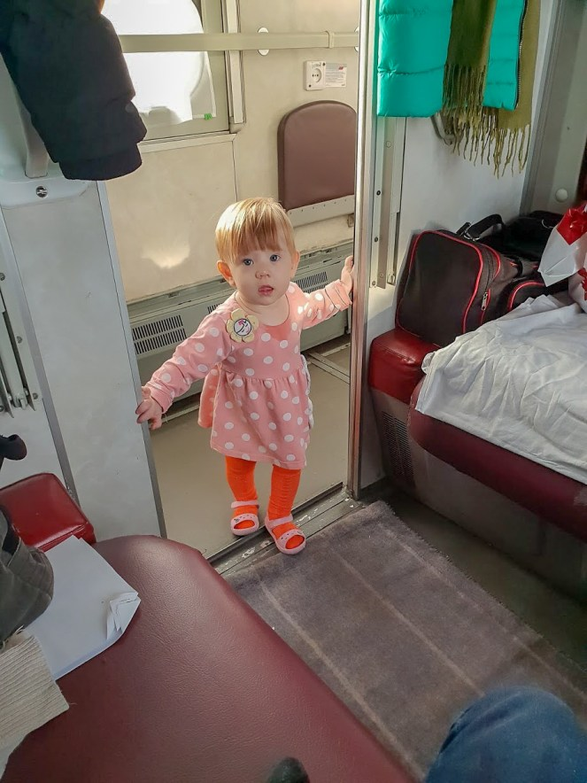 a little girl in a second class coupe of the Trans-Siberian Train